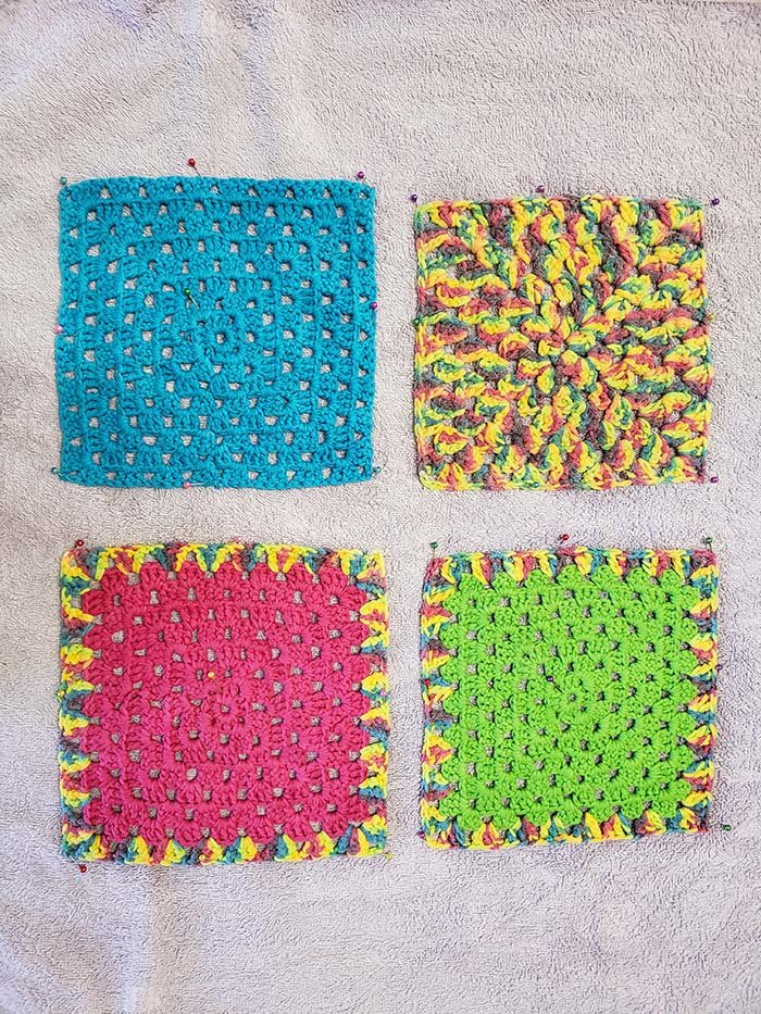 Crochet Squares pinned to block