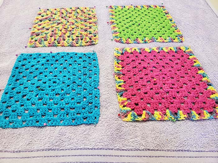 I used a doubled over old clean towel to block my squares