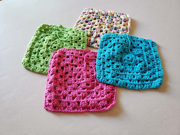 Unblocked crochet squares ready for finishing and blocking