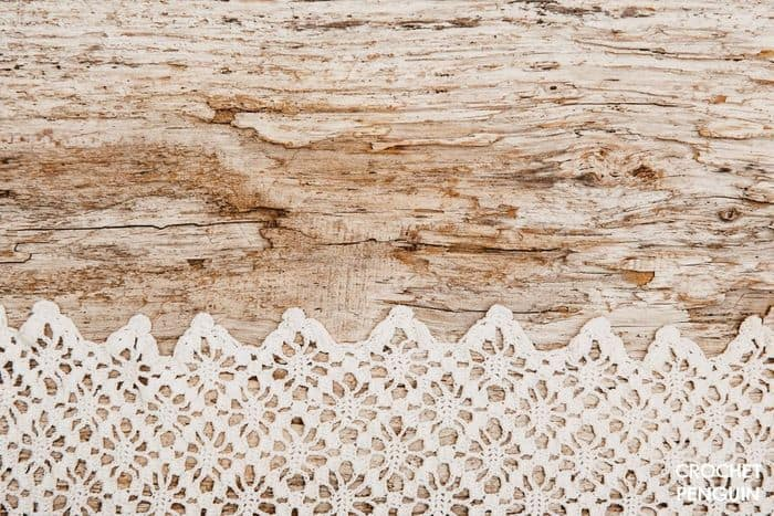 Fine lace crochet on a wooden surface