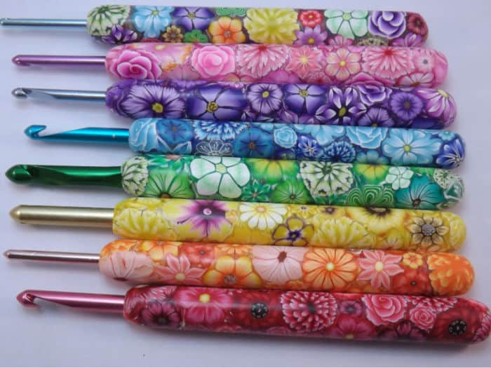 Extra length polymer clay Happy Crochet Hooks with colorful floral designs