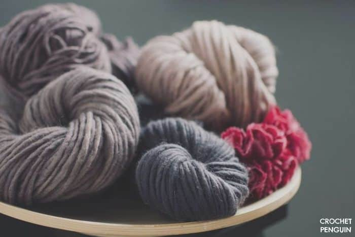 grey  and cream yarns in a bowl