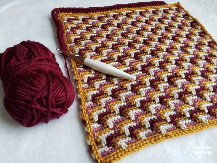 The slip stitches are in mustard yellow yarn to add the double crochet border stitches in a plum colored yarn.