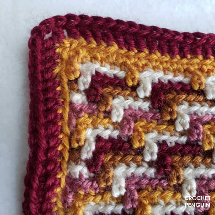 Close up of the slip stitches and double crochet border stitches.