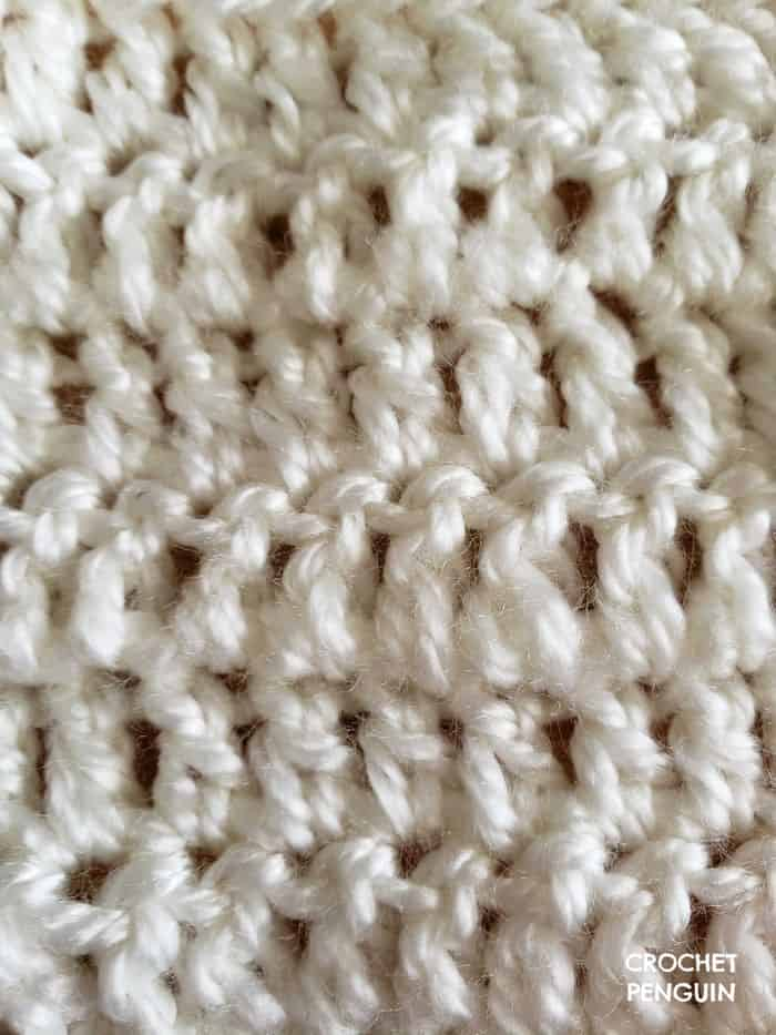 Close up of Double Crochet stitches in white yarn